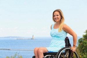 Woman with spinal cord injury in wheelchair on holiday